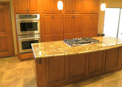 Cherry Cabinets Curved Island Kitchen Remodel
