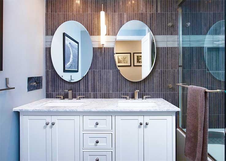 Custom tile work on bathroom wall exceptional detail creates dramatic affect.